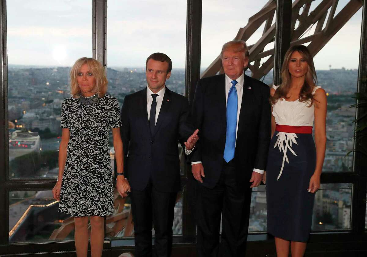 From left to right : Brigitte Macron, wife of French President Emmanuel Macron, Emmanuel Macron, U.S. President Donald Trump and First lady Melania Trump pose at the Jules Verne restaurant before a private dinner at the Eiffel Tower in Paris, France, Thursday, July 13, 2107. (Yves Herman/Pool Photo via AP)