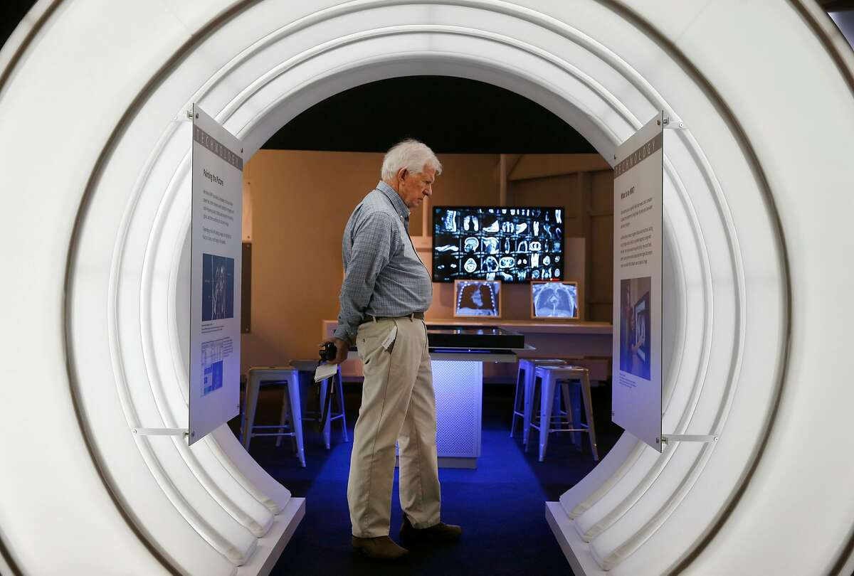 Corrie Grov� views a display on MRI technology at the Computer History Museum in Mountain View, Calif. on Wednesday, July 12, 2017.