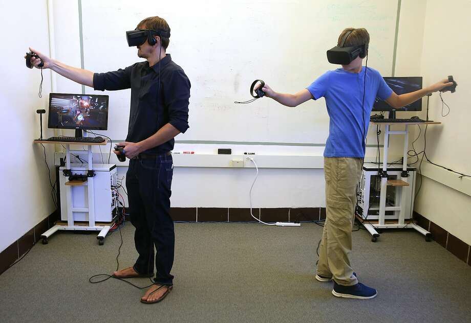 Edwin (left) and son Sasha try out Oculus at Urban Safari in San Francisco. Photo: Liz Hafalia, The Chronicle
