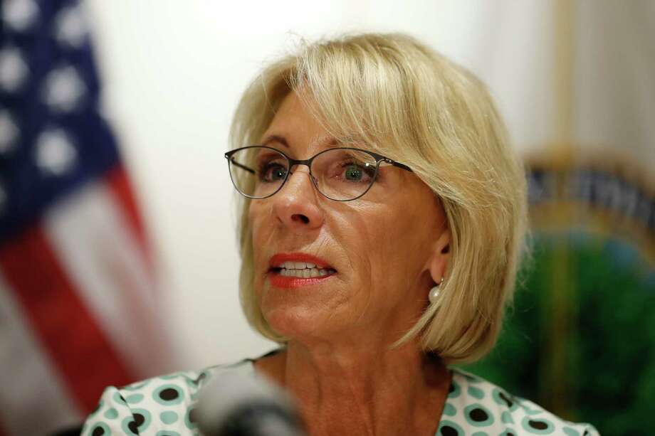 In this July 2017 file photo, U.S. Education Secretary Betsy DeVos speaks with the media after a series of listening sessions about campus sexual violence in Washington. (AP Photo/Alex Brandon) Photo: Alex Brandon, STF / Copyright 2017 The Associated Press. All rights reserved.