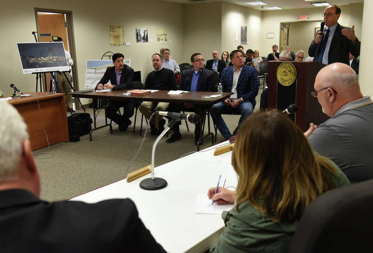 Planning Commissioner Steven Strichman, right, speaks during a meeting where Bonacio Construction and Bow Tie presented a proposed square movie theater project to the City Council Planning and Economic Development Committee at City Hall Wednesday, April 5, 2017 in Troy, N.Y. (Lori Van Buren / Times Union)
