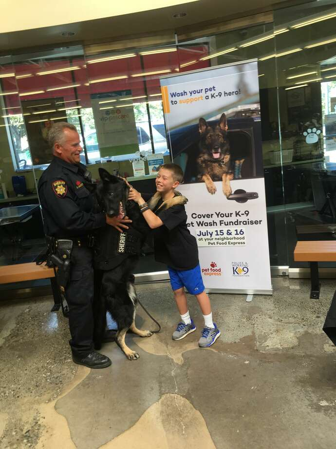 Wyatt, 9, poses with San Francisco police officers and canines at a Cover Your K-9 event. Photo: Cover Your K-9