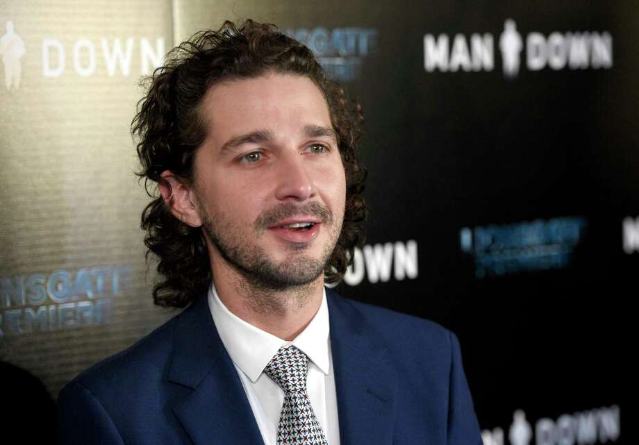 """FILE - In this Nov. 30, 2016 file photo, Shia LaBeouf arrives at the Los Angeles premiere of """"Man Down"""" at ArcLight Cinemas Hollywood. LaBeouf has apologized for a racist tirade against officers who arrested him for public drunkenness over the weekend in Savannah, Ga. The actor wrote in a statement posted on Twitter Wednesday, July 12, 2017, that he has been publicly struggling with addiction for what he was said was """"far too long."""" (Photo by Chris Pizzello/Invision/AP, File) ORG XMIT: CAET738 Photo: Chris Pizzello / Invision"""
