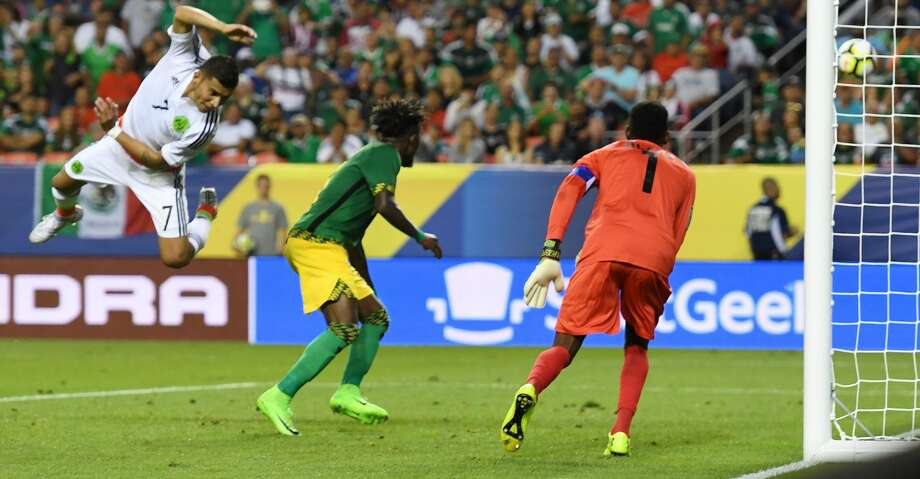 Mexico's Orbelin Pineda (L) misses a shot on goal against Jamaica during the Mexico vs Jamaica CONCACAF Group C Gold Cup soccer game on July 13, 2017 at Sports Authority Field at Mile High in Denver, Colorado.  / AFP PHOTO / MARK RALSTONMARK RALSTON/AFP/Getty Images Photo: MARK RALSTON/AFP/Getty Images