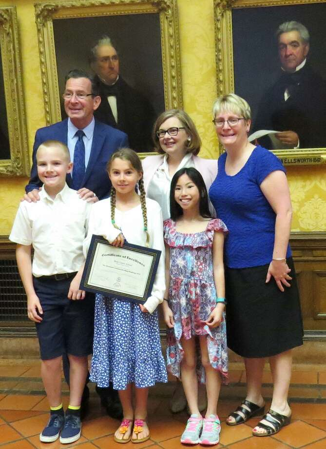 Kent Center School students, from left to right, in front, Seth Schellery, Lola Moerschell and Terra McGurk and teacher Betsy Morrow, back right, are congratulated by Governor Dannel Malloy and Dianna R. Wentzell of the Commission on Education for student excellence in the Governor's 2016 Summer Reading Challenge. Photo: Courtesy Of Kent Center School / The News-Times Contributed