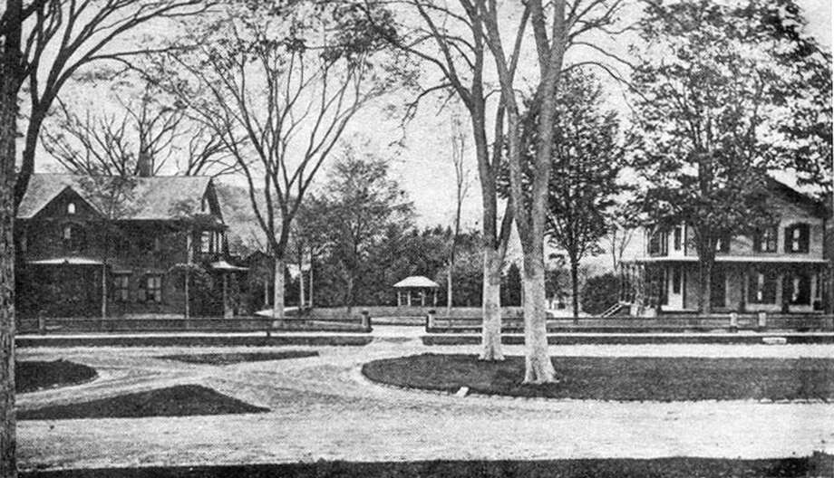 """The face of the New Milford Village Green has evolved over the years and yet retained much of the same features of the past. In the late 1890s, the west side of the Green along Main Street included the Episcopal Church rectory, left, and the home of Mr. and Mrs. Joseph Nettleton. The bandstand situated between was shared by the two residences. The two homes were located roughly where the post office is in the early 21st century north to where the Greater New Milford Spectrum office is. The intersection between east and west sides of the Green was eliminated at that spot and another was created across from Boardman Terrace at the end of the 20th century. If you have a """"Way Back When"""" photo to share, contact Deborah Rose at drose@newstimes.com or 860-355-7324. Photo: Courtesy Of The Bona Family"""