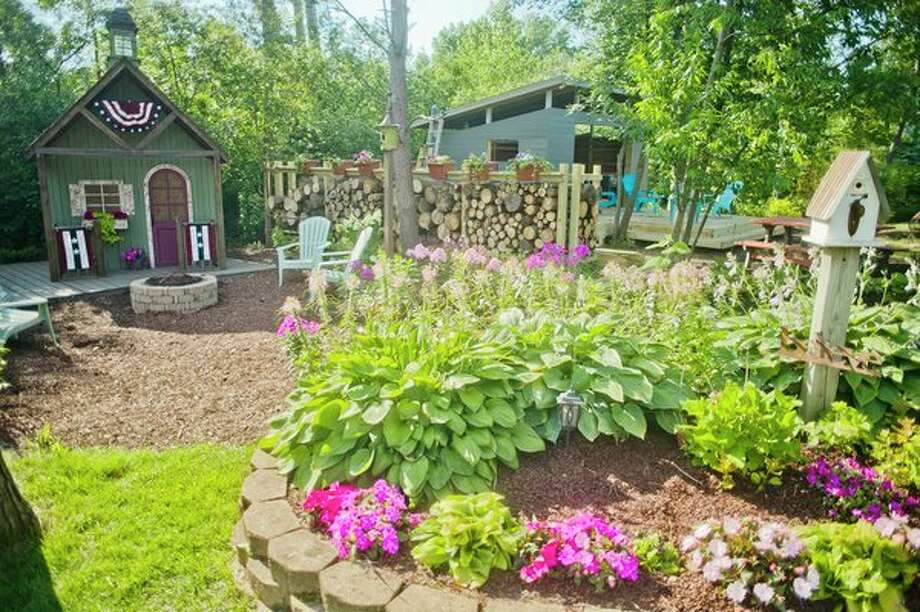 Sam and Kelly PeLong's backyard cottage garden. (Katy Kildee/kkildee@mdn.net)