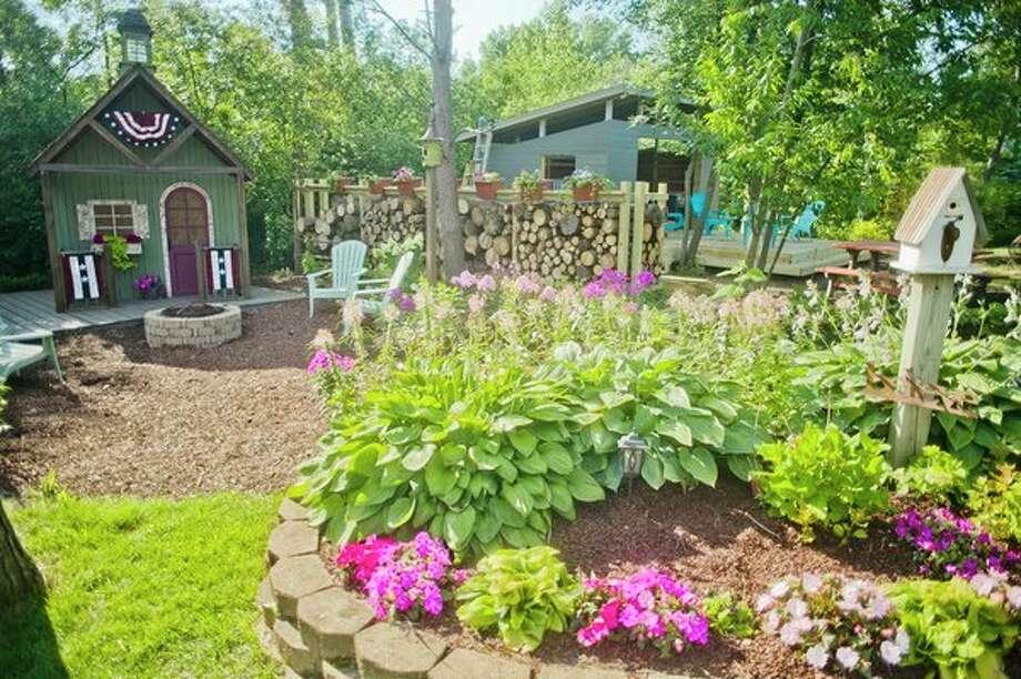 Sam and Kelly PeLong's backyard cottage garden. (Katy Kildee/kkildee@mdn.net)