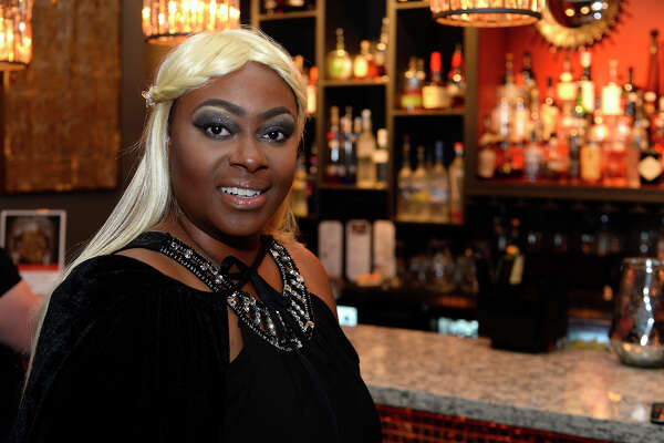 LaDonna Sherwood, who dressed as character Daenerys Stormborn, during the Game of Thrones trivia night at Portus Lounge on Thursday. The event followed their recent popular Harry Potter trivia night.  Photo taken Thursday 7/13/17 Ryan Pelham/The Enterprise