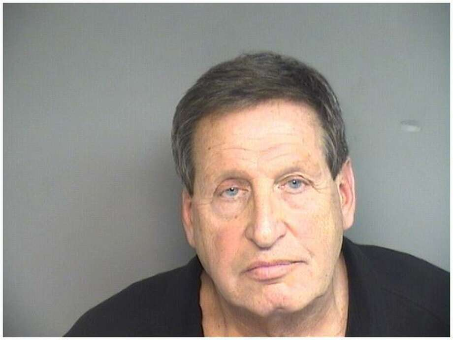 Stamford attorney L. Morris Glucksman, 70 pleaded guilty to stealing over $200,000 from two dead clients. He faces up to five years in jail when he returns for sentencing in September. Photo: Stamford Police Department / Contributed Photo / Stamford Advocate Contributed