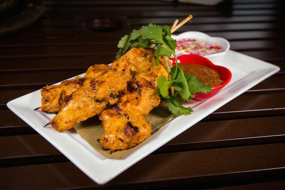 Satay Gai (Chicken Satay) skewers from Chef Jett Hurapan with Songkran Thai Kitchen in Uptown.