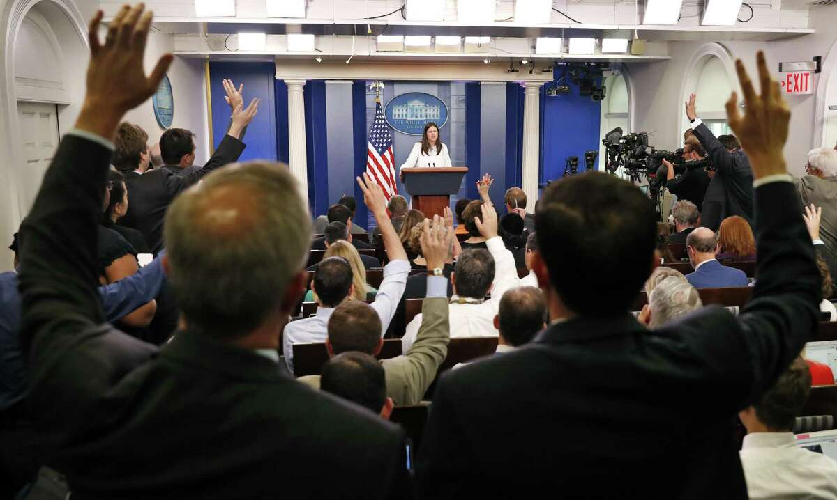 Deputy White House press secretary Sarah Huckabee Sanders speaks as reporters hold their hands up to ask a question, during an off-camera press briefing at the White House in Washington, Wednesday, July 12, 2017.