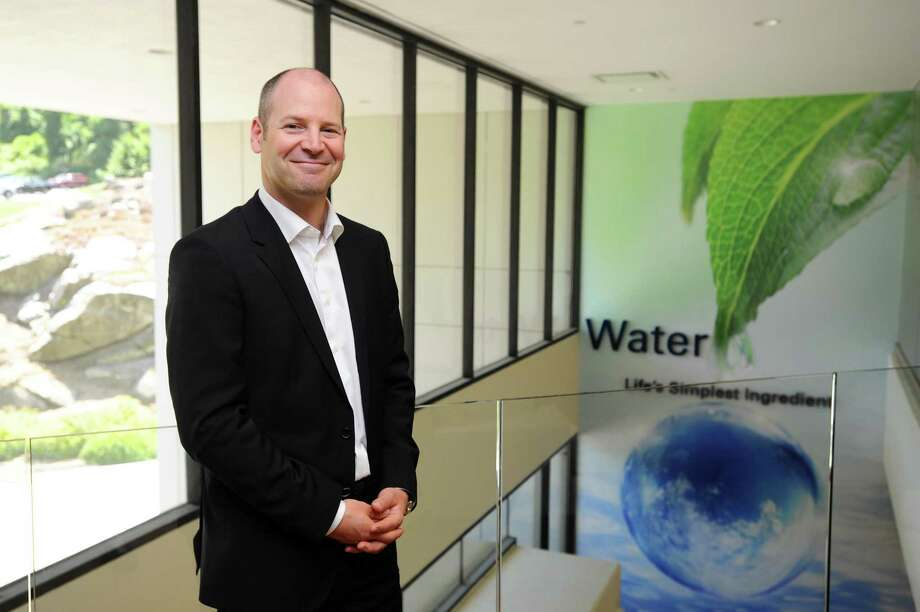 Nelson Switzer, Nestlé Waters North America's chief sustainability officer, poses for a photo inside the NWNA headquarters at 900 Long Ridge Road, in Stamford, Conn. on Wednesday, July 5, 2017. Photo: Michael Cummo / Hearst Connecticut Media / Stamford Advocate