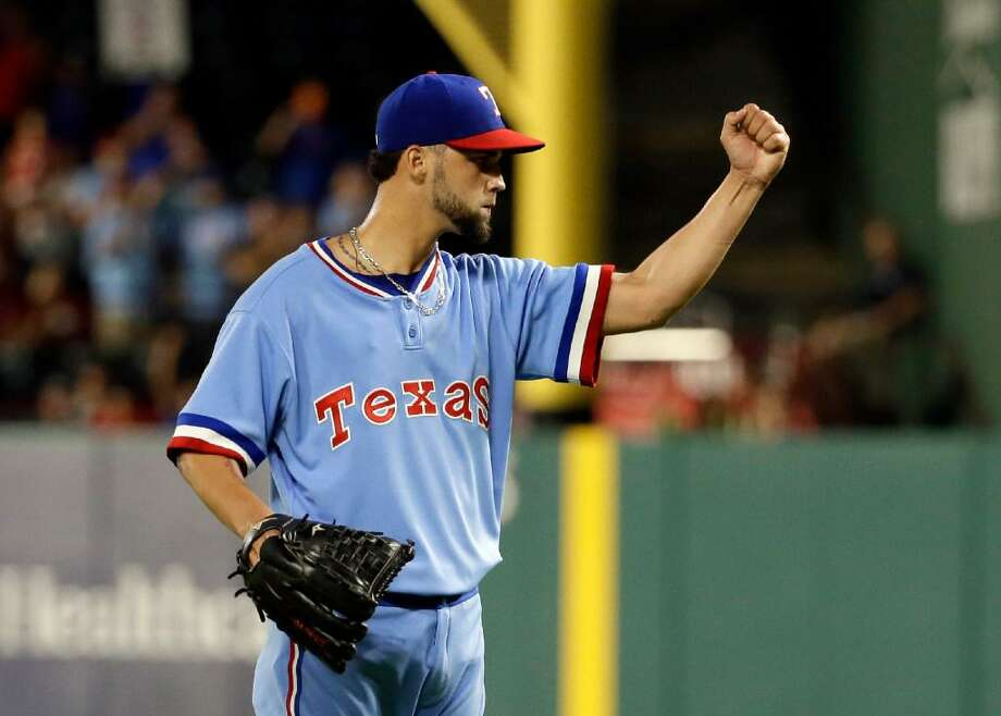 Texas Rangers relief pitcher Alex Claudio celebrates getting the final out against the Los Angeles Angels in a baseball game, Saturday, July 8, 2017, in Arlington, Texas. The Rangers won 5-2. Photo: Tony Gutierrez /AP Photo