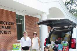 Bankwell unloads pet supplies at the CT Humane Society in Westport June 30. From left: Bankwell Wilton Branch Manager Ann Mitrione, Executive Assistant to Bankwell CEO Lynne Gomez, Bankwell Marketing Associate Lucy French and CT Humane Society Westport District Manager Bliss Kern.