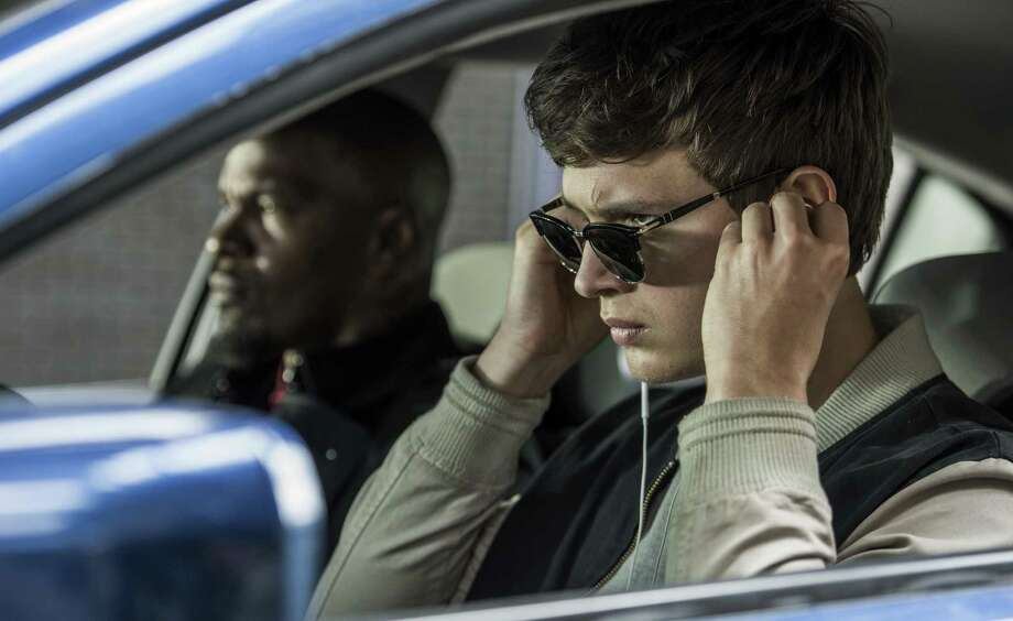 """Ansel Elgort, right, and Jamie Foxx in a scene from """"Baby Driver."""" It's the ultimate cliche to compare a movie to a thrill ride, but sometimes the cliche applies. (Wilson Webb/Sony/TriStar Pictures via AP) Photo: Wilson Webb / Sony / TriStar Pictures / Associated Press / © 2016 CTMG, Inc. All Rights Reserved.**ALL IMAGES ARE PROPERTY OF SONY PICTURES ENTERTAINMENT INC. FOR PROMOTIONAL USE ONLY. SA"""