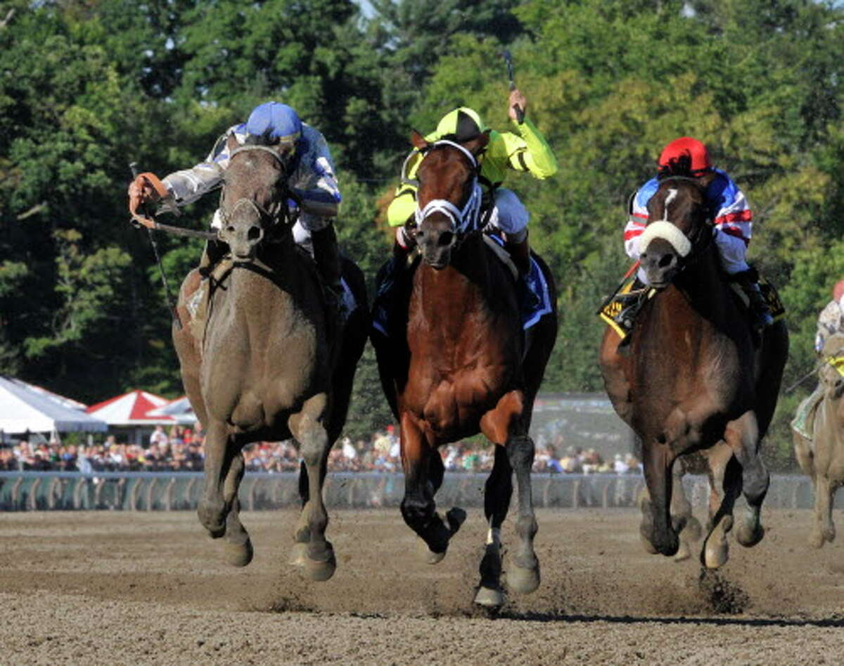 Blame ridden Garrent Gomez moves up on the outside(l) to beat favorite Quality Road with jockey John Velazquez(c) and Musket Man(r) with jockey Rajiv Maragh to win the 83rd running of The Whitney Stake a the Saratoga Race Course in Saratoga Springs, New York August 7, 2010. (Skip Dickstein/Times Union)