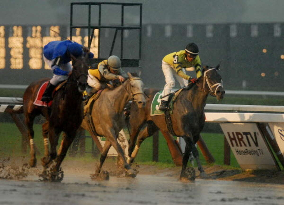 L-R: The winner, the No. 1, horse, Seventh Street, cq., with Rajiv Maragh, in the saddle, No. 4, Miss Isella, cq., with Julien Leproux, cq., up, who finished second, and the No. 5, Spritely, cq., with Edgar Prado, aboard, finished third, coming down the stretch to the finish, in ninth race, the 56th Running of The Go For Wand, on Sunday, Aug. 2, 2009, in Saratoga Springs, NY, and one of two feature races on the day's racing card. Saratoga Race Track (Luanne M. Ferris / Times Union)