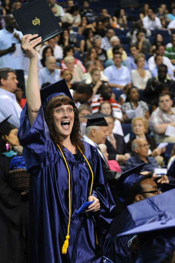 Robin Booth of Milford holds up her diploma during the Housatonic Community College graduation at the Webster Bank Arena at Harbor Yard on Thursday, May 26, 2011. Photo: Lindsay Niegelberg / ST / Connecticut Post
