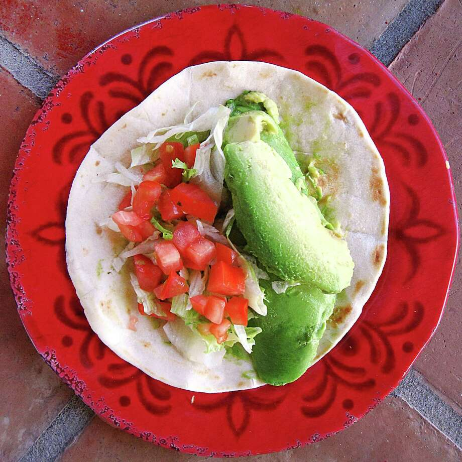 Aguacate (avocado) taco with lettuce and tomato on a flour tortilla from El Bracero. Photo: Mike Sutter /San Antonio Express-News