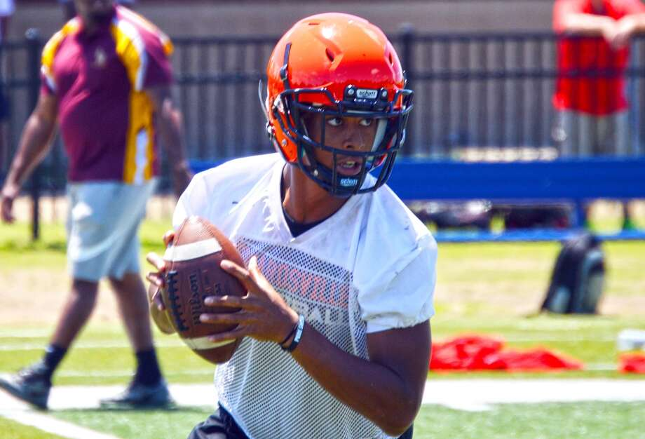 Edwardsville's Kendall Abdur-Rahman throws a pass during a 7-on-7 tournament at Missouri Baptist University.