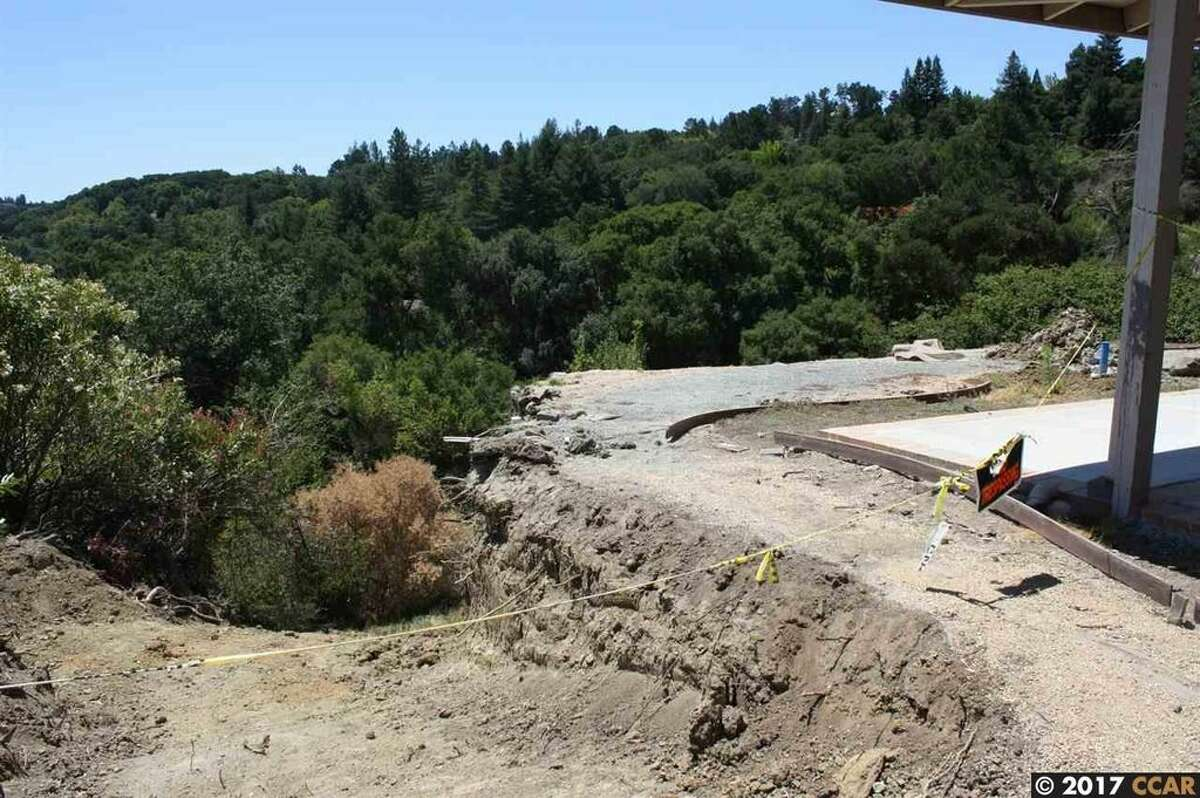 A home at 21 Chapel Dr. in Lafayette, Calif., was red-tagged - declared too dangerous to inhabit by the city - after a landslide in February 2017. The property is now on the market for $850,000 and offers an opportunity for a homebuyer seeking a project.