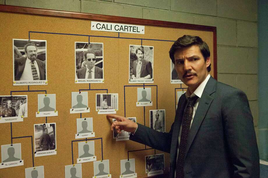"The third season of Netflix's ""Narcos"" is switching adversaries in season 3. With Pablo Escobar now dead, DEA agents Javier Pena and Steve Murphy are focusing on the new player in the Colombian drug war: The Cali Cartel. Keep going for a rough timeline of sorts on the most important events that marked this drug organization from the 1970s to 1998. / Juan Pablo Gutierrez/Netflix"