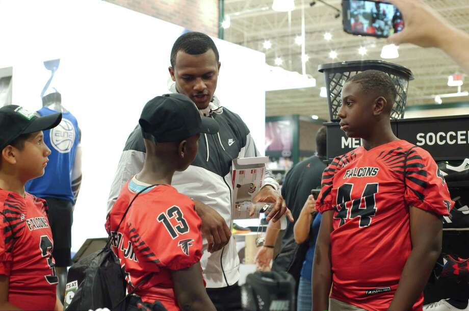 Eric Brown and Evante Williams get some product advice from Houston Texans quarterback Deshaun Watson during a shopping spree to spend $150 gift cards awarded to the Southeast Falcons Football Association as part of grant from Dicks Sporting Goods Friday, Jul 14. Photo: Kirk Sides, Houston Chronicle / © 2017 Kirk Sides / Houston Chronicle