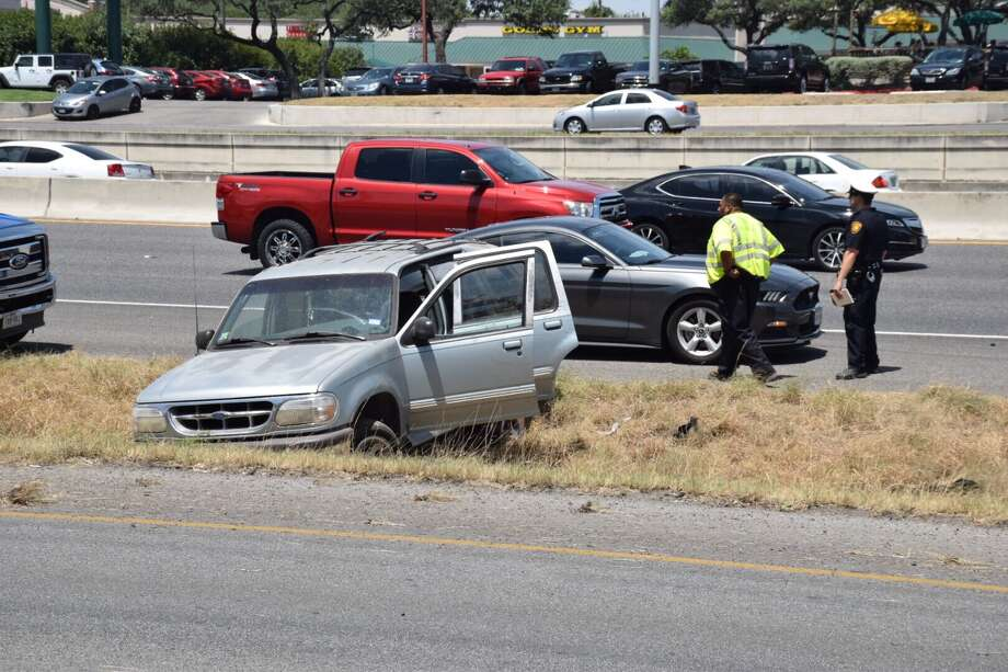 A 21-year-old driver was arrested Friday, July 14, 2017, after he flipped his Ford SUV on U.S. Highway 281 and then tried to flee the scene. Photo: Caleb Downs / San Antonio Express-News
