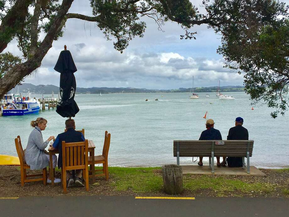 Vacationers and local relax along the waterfront Strand in Russell. Photo: Jill K. Robinson, Special To The Chronicle