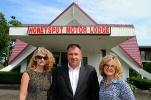 Stratford Community Care Program workers Kate Venison, left, Larry Ciccarelli Jr. and Tammy Trojanowski pose in front of the Honeyspot Motor Lodge in Stratford, Conn., on Wednesday July 12, 2017. Venison is the program's Clinical Coordinator, Larry is Stratford's Public Safety Director and Tammy is the program administrator. The Community Care Program goes to places like this motel to help guests or residents and try to intervene when trouble arises. The new town initiative helps to offer solutions, not incarceration, to people who commit minor crimes or who need help with opioid addiction. The program works to get people better in touch with the services they need.