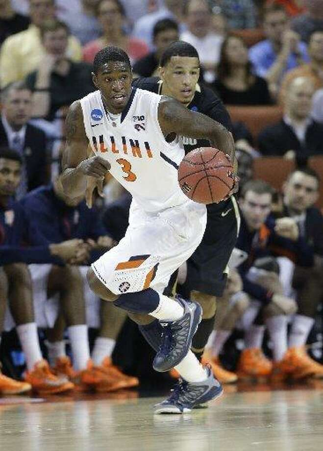 Illinois' Brandon Paul (3) during the first half of a second-round game of the NCAA college basketball tournament Friday, March 22, 2013, in Austin, Texas. Photo: Eric Gay /AP Photo