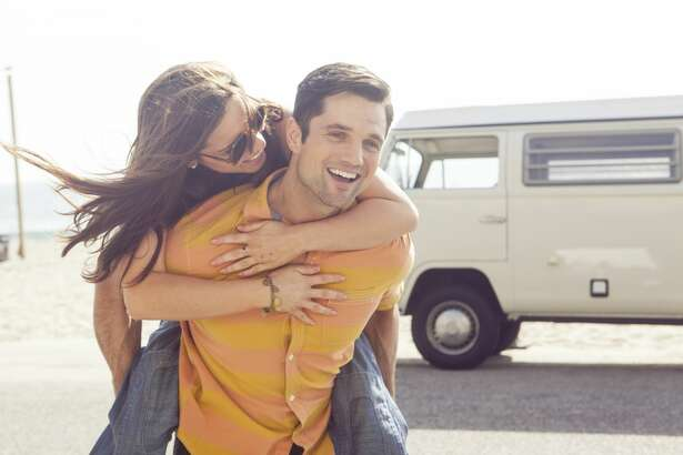 Young couple on vacation in camper van