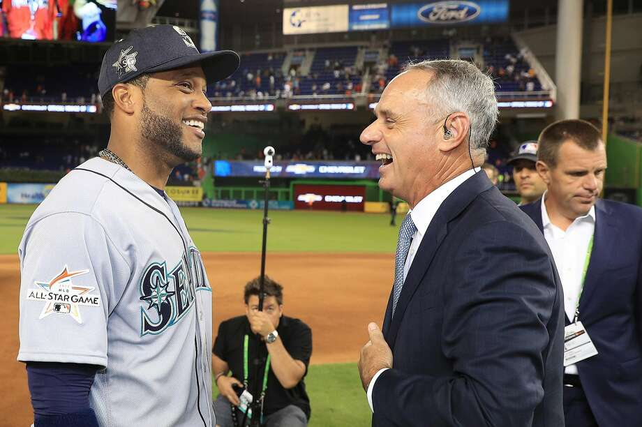 Robinson Cano of the Seattle Mariners talks with MLB Commissioner Rob Manfred after defeating the National League 2-1 in the MLB All-Star Game in Miami. Photo: Mike Ehrmann, Getty Images