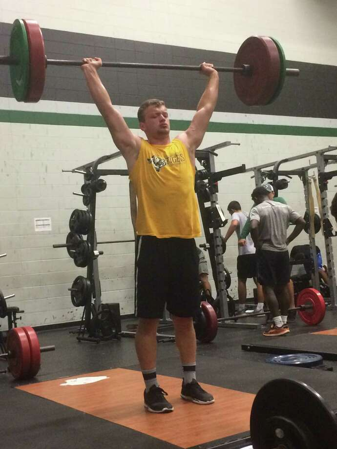 Regan Wilkins power cleans 155 pounds at the Kingwood Park Summer Strength and Conditioning Camp Photo: Elliott Lapin