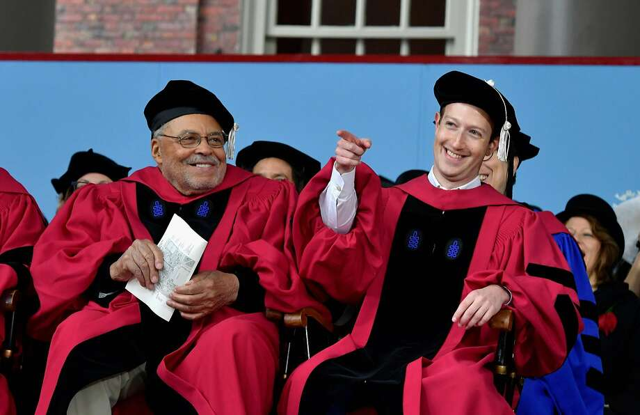 Facebook CEO Mark Zuckerberg (right), shown in May receiving an honorary degree from Harvard, also supports the universal income concept. Photo: Paul Marotta, Getty Images