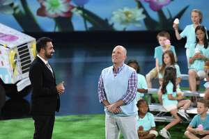 """Contestant Jonathan Matte of Stratford with host Kal Penn as he competes for a $50,000 prize on the set of """"Superhuman"""" on Fox. The show will air Monday, July 17, at 9 p.m."""