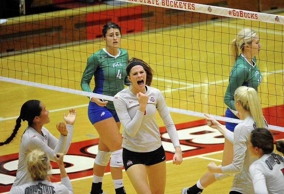 Former Magnolia High School volleyball player Kylie Randall celebrates a point during a game with Ohio State. Photo: Ohio State Athletics