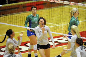Former Magnolia High School volleyball player Kylie Randall celebrates a point during a game with Ohio State.