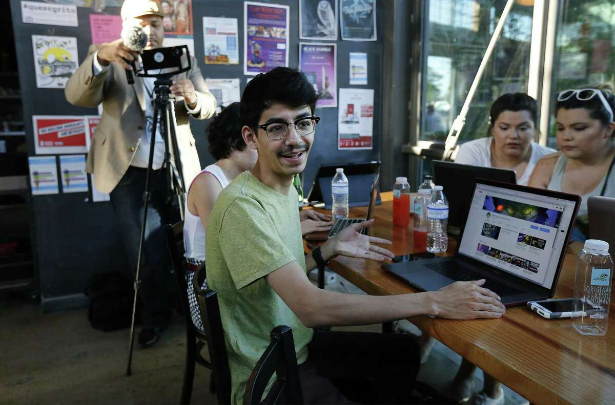 Jorge Aguilar II (pictured) gives the YouTube group advice during their weekly meetup at Rosella Coffee. The group meets weekly on Wednesday evenings.