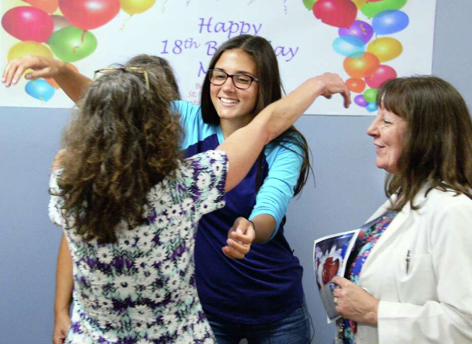 Born prematurely, Molly Sear, center, of Johnstown greets her then Neonatal Intensive Care Unit nurses Anne Whitelonis and Anne Riley, right, as she returns to St. Peter's Hospital to celebrate her 18th birthday Friday July 14, 2017 in Albany, NY. Molly's mother Lisa Smith is at left.  (John Carl D'Annibale / Times Union) Photo: John Carl D'Annibale, Albany Times Union / 40041045A