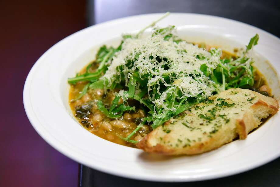 Linguisa and ham-hock stew topped with arugula and Beemster cheese, and served with crostini with anchovy butter served for lunch at Salvation Army's Harbor Light Treatment Center. Photo: Michael Short, Special To The Chronicle