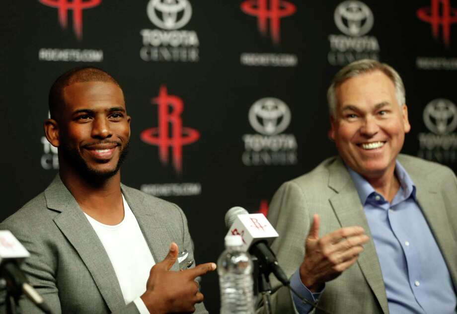 Chris Paul laughs with coach Mike D'Antoni after he was asked if he was going to get a grill, and coach thought he was talking about a smoker, as they spoke to the media before being introduced to Houston Rockets fans at the Toyota Center, Friday, July, 14, 2017. Photo: Karen Warren, Houston Chronicle / 2017 Houston Chronicle
