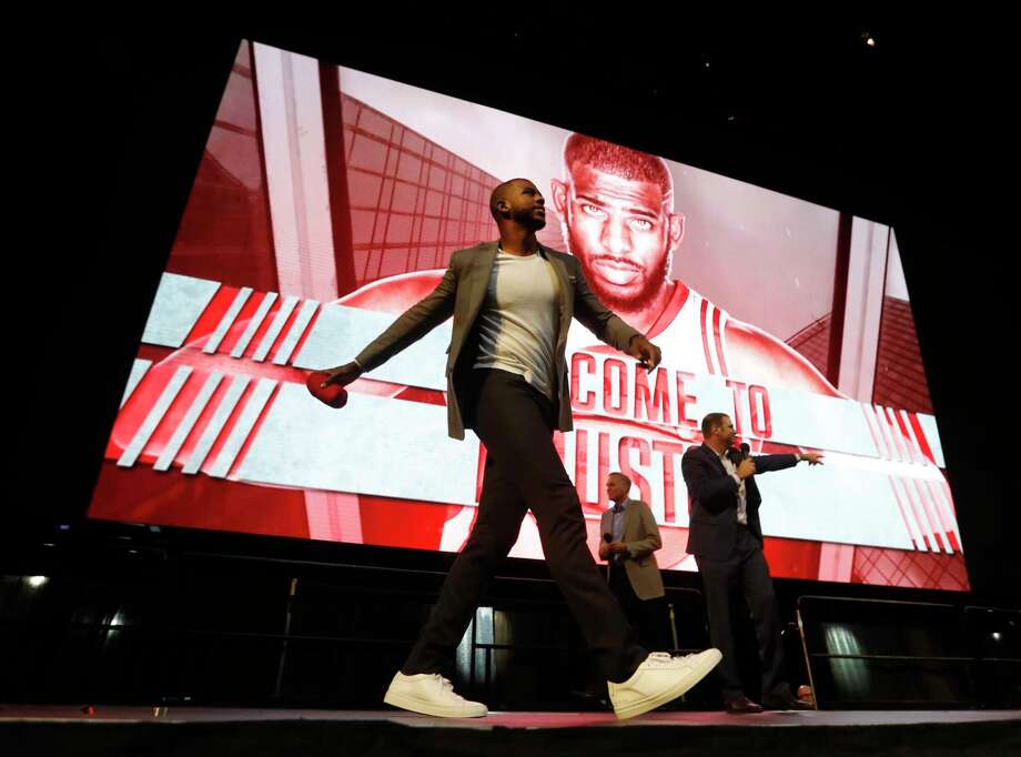 Chris Paul throws a t-shirt to the crowd after he was introduced to Houston Rockets fans at the Toyota Center, Friday, July, 14, 2017. Photo: Karen Warren, Houston Chronicle / 2017 Houston Chronicle