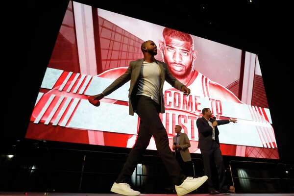 Chris Paul throws a t-shirt to the crowd after he was introduced to Houston Rockets fans at the Toyota Center, Friday, July, 14, 2017.