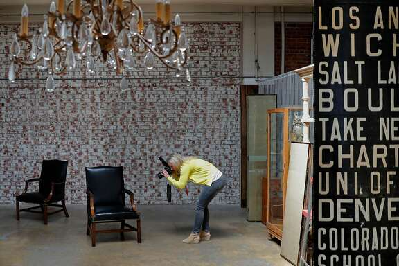 Erin Lane of Erin Lane Estates runs the online vintage furniture marketplace Chairish, out of their warehouse in Oakland, Ca., as seen on Thursday July 13, 2017. Lane uses the warehouse as a background to photograph her wares.