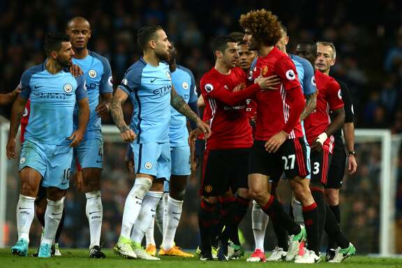 Manchester City v Manchester United - Premier League MANCHESTER, ENGLAND - APRIL 27: Marouane Fellaini of Manchester United reacts to Sergio Aguero of Manchester City after being sent off during the Premier League match between Manchester City and Manchester United at Etihad Stadium on April 27, 2017 in Manchester, England. (Photo by Robbie Jay Barratt - AMA/Getty Images) Restrictions Restrictions: Strictly Editorial Use Only.EDITORIAL USE ONLY. No use with unauthorized audio, video, data, fixture lists, club/league logos or 'live' services. Online in-match use limited to 75 images, no video emulation. No use in betting, games or single club/league/player publications Details Credit: Robbie Jay Barratt - AMA / Contributor