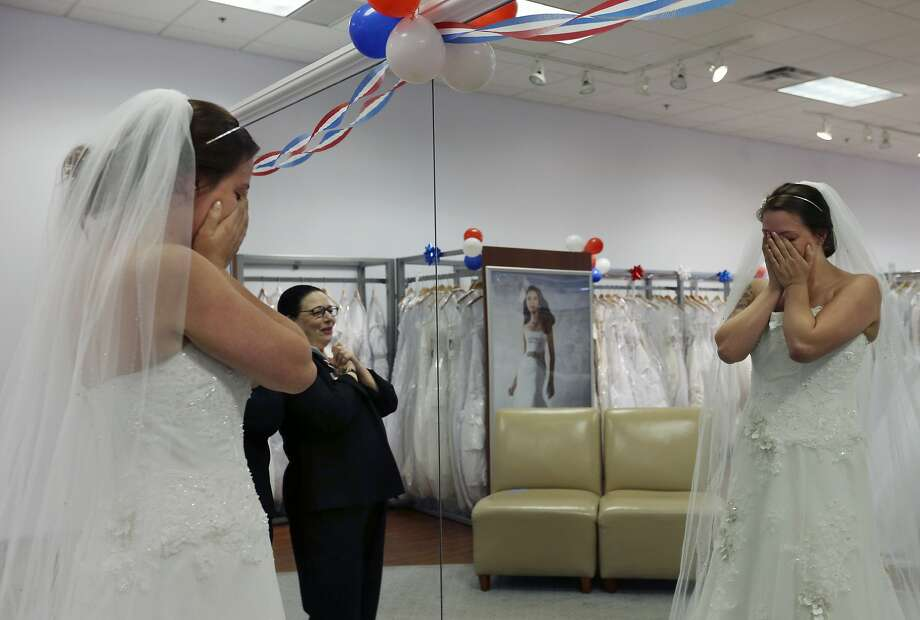 Store employee Jo Acchione, left, stands near as former Army National Guard member, Jennifer Dunn, is overcome as she chooses a wedding gown at Alfred Angelo Bridal, Wednesday, Nov. 11, 2015, in Cherry Hill, N.J. Getting married? Try not to do what these Reddit users experienced in the next slides. Photo: Mel Evans, Associated Press