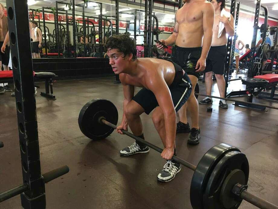 Andy James in between deadlift reps of 275 pounds at the Falcon Athletic Training Camp Photo: Elliott Lapin