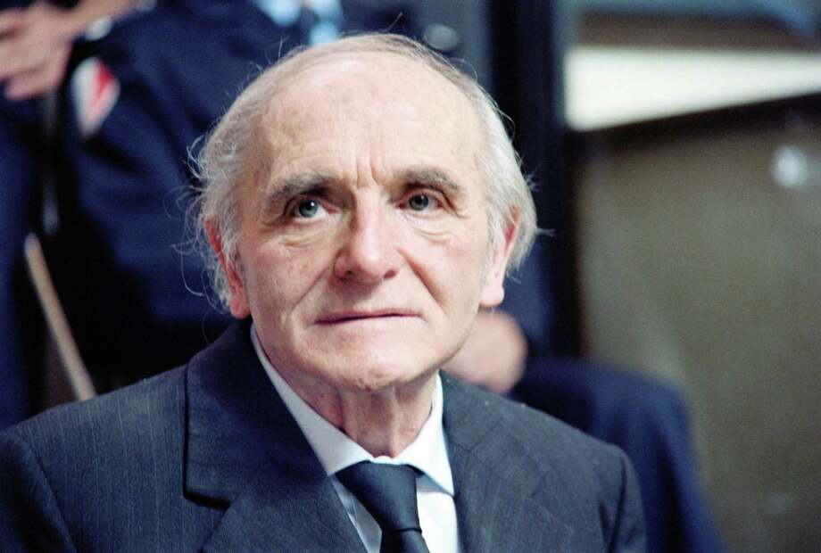 """Former SS officer Klaus Barbie, the """"Butcher of Lyon,"""" expelled by Bolivia, waits in a courthouse in Lyon on May 11, 1987, on the first day of his trial on charges of crimes against humanity. He was sentenced to life in prison and died four years later. Photo: STF /AFP /Getty Images / AFP or licensors"""